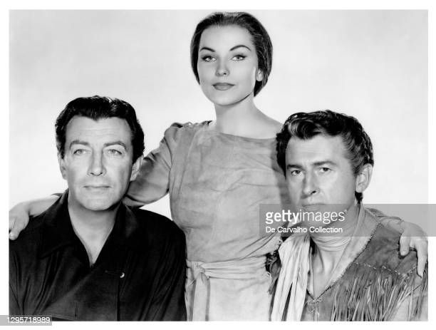 Actor Robert Taylor as 'Charles Gilson', Actress Debra Paget as 'Indian Girl' and Actor Stewart Granger as 'Sandy McKenzie' in a publicity shot from...