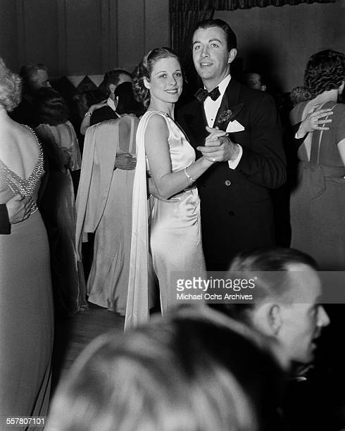 Actor Robert Taylor dances with Janet Gaynor at an event in Los Angeles California