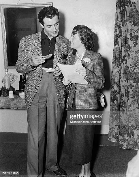 Actor Robert Taylor poses with actress Janet Gaynor in Los Angeles California