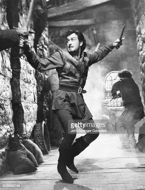 Actor Robert Taylor swordfighting in a scene from the 1952 film Ivanhoe Taylor played the role of the disowned knight Ivanhoe who joins Robin Hood