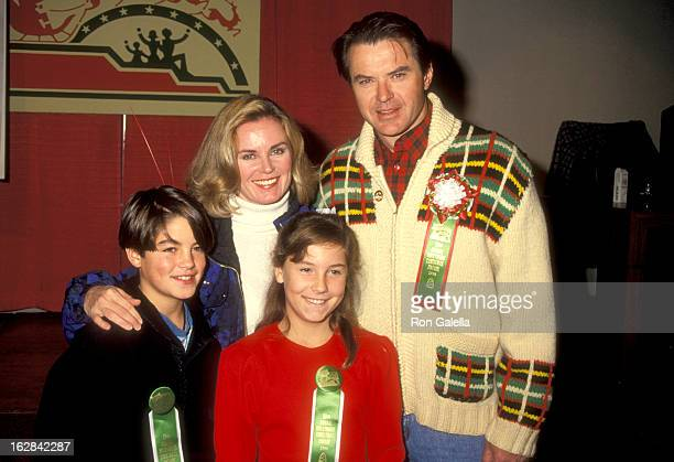 Actor Robert Urich wife Heather Menzies son Ryan Urich and daughter Emily Urich attend the 59th Annual Hollywood Christmas Parade on November 25 1990...