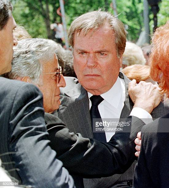 Actor Robert Wagner and singer Tony Bennett hug following the funeral services for the worldfamous entertainer Frank Sinatra at the Good Shepherd...
