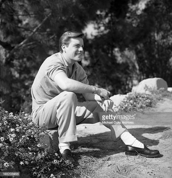 Actor Robert Wagner poses for a portrait session at the home of photographer Earl Leaf on February 28 1956 in Los Angeles California