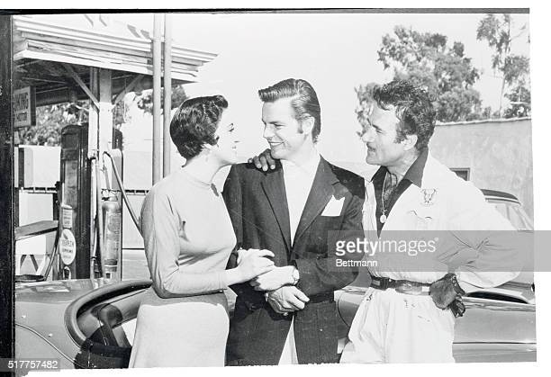 """Actor Robert Wagner, returning to Hollywood from Mexico, introduces his """"Mother,"""" Katy Jurado, who played his mother in Broken Lance, to his father,..."""