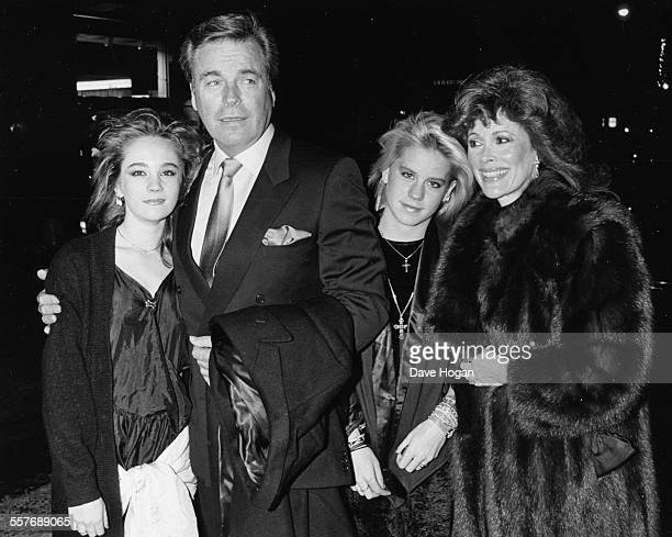 Actor Robert Wagner with his wife Jill St John and daughter Courtney and Natasha at a New Years Eve party in London December 31st 1986