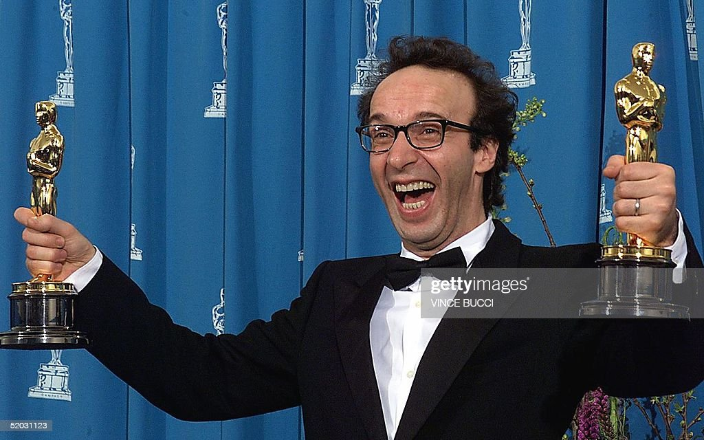 Actor Roberto Benigni Of Italy Holds His Two Oscars For Best Foreign Language Film And Best