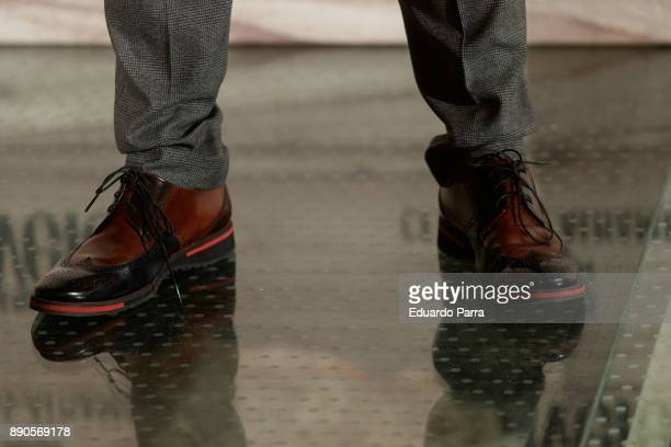 Actor Roberto Manrique shoes detail attends the 'Conde Nast Traveler Gastronomic and Wine Guide' photocall at Florida Retiro on December 11 2017 in...