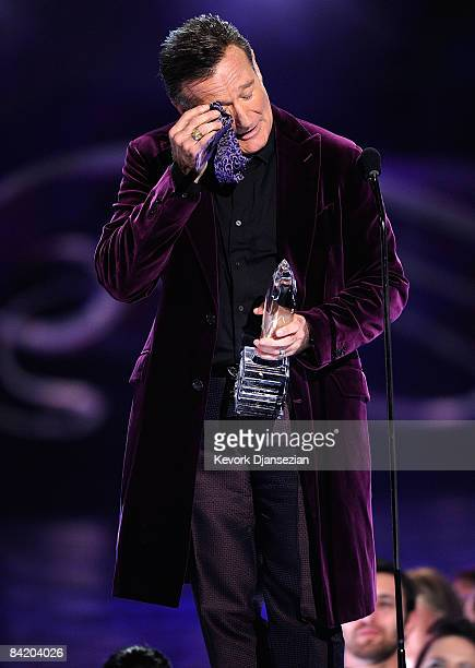 Actor Robin Williams accepts the Favorite Scene Stealing Guest Star award during the 35th Annual People's Choice Awards held at the Shrine Auditorium...