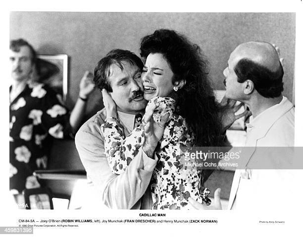 "Actor Robin Williams and actress Fran Drescher on set of the movie "" Cadillac Man"" , circa 1990."
