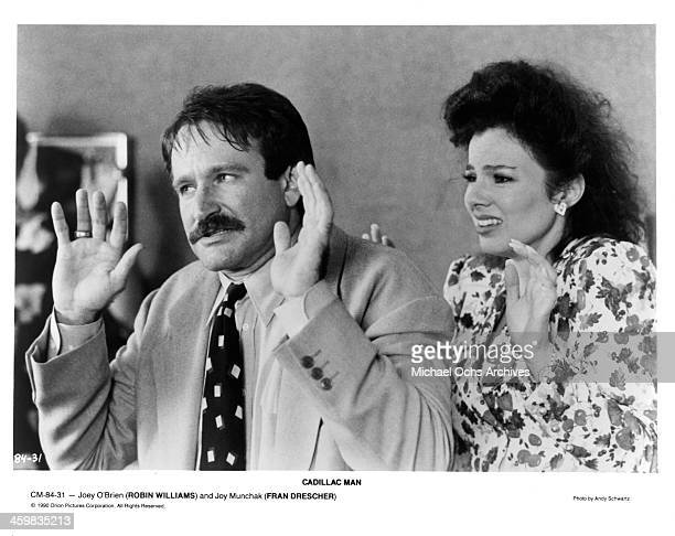 "Actor Robin Williams and Fran Drescher on set of the movie "" Cadillac Man"" , circa 1990."