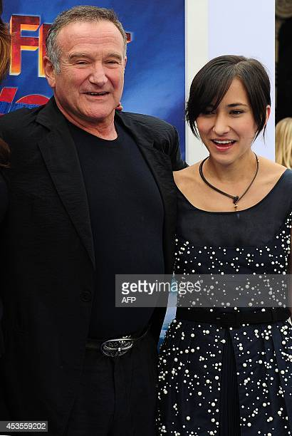 Actor Robin Williams and his daughter Zelda pose on arrival for the world premiere of the movie 'Happy Feet Two' in Hollywood on November 13 2011 in...