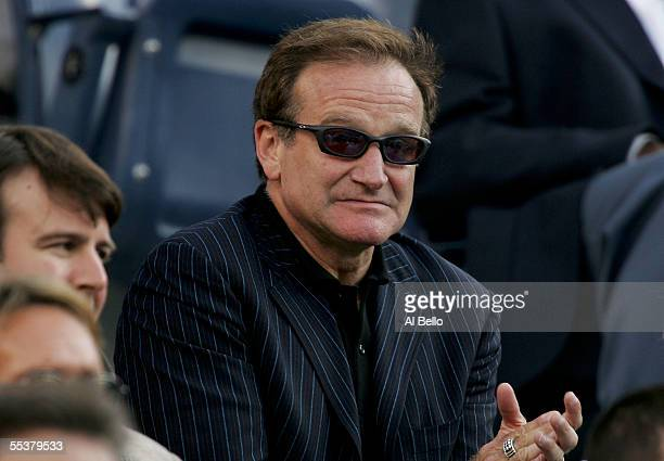 Actor Robin Williams cheers during the men's final between Andre Agassi and Roger Federer of Switzerland at the US Open at the USTA National Tennis...