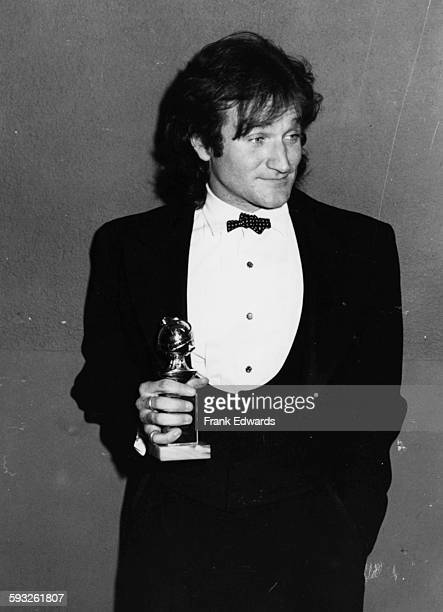 Actor Robin Williams holding his award for the television show 'Mork and Mindy' at the Golden Globe Awards Los Angeles January 1979
