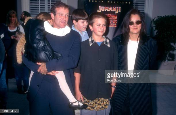 Actor Robin Williams holds his daughter Zelda as he poses with his son Zachary and wife Marsha during the 'Jumanji' Culver City Premiere on December...