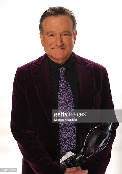 Actor Robin Williams poses for a portrait with his award for Scene Stealing Guest Star during the 35th Annual People's Choice Awards held at the...