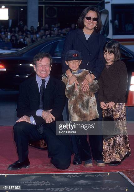 Actor Robin Williams wife Marsha daughter Zelda and son Cody attend Robin Williams hand and footprints in cement ceremony on December 22 1998 at the...