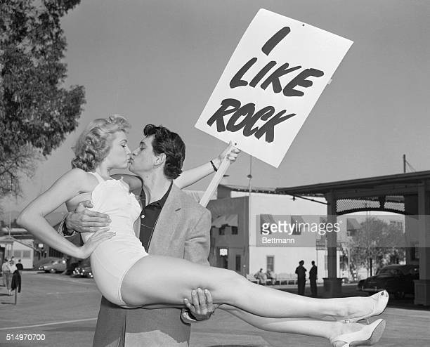 "Actor Rock Hudson gets a kiss from his shapely ""campaign manager"" Kathleen Hughes, as he campaigns for mayor of Universal City, home of..."