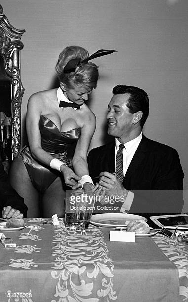 Actor Rock Hudson signs the cuff of a Playboy Bunny at a dinner for the Motion Picture Pioneers Association at the Playboy Club on November 19 1962...