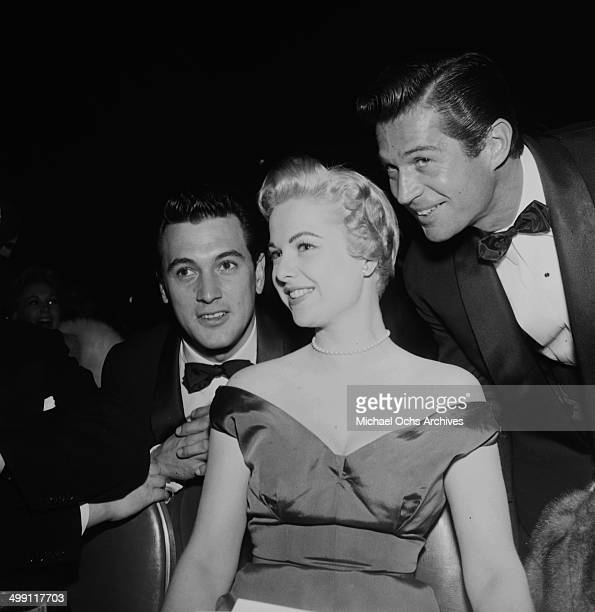 Actor Rock Hudson with Martha Hyer and George Nader pose at a party in Los AngelesCalifornia