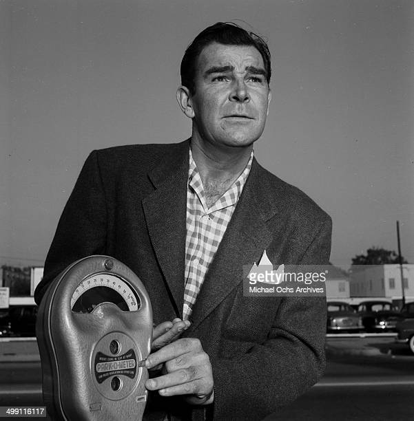 Actor Rod Cameron poses with a parking meter in Los Angeles California