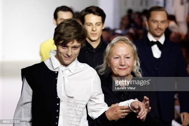 Actor Rod Paradot and Designer Agnes B walk the runway during the Agnes B Menswear Spring/Summer 2019 show as part of Paris Fashion Week on June 24...