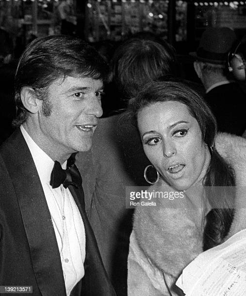 Actor Roddy McDowall and guest attend the premiere of 'Dr Dolittle' on December 16 1967 at Loew's State Theater in New York City