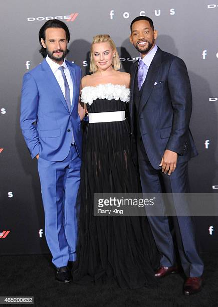 Actor Rodrigo Santoro actress Margot Robbie and actor Will Smith arrive at the Los Angeles World Premiere Of Warner Bros Pictures 'Focus' at TCL...