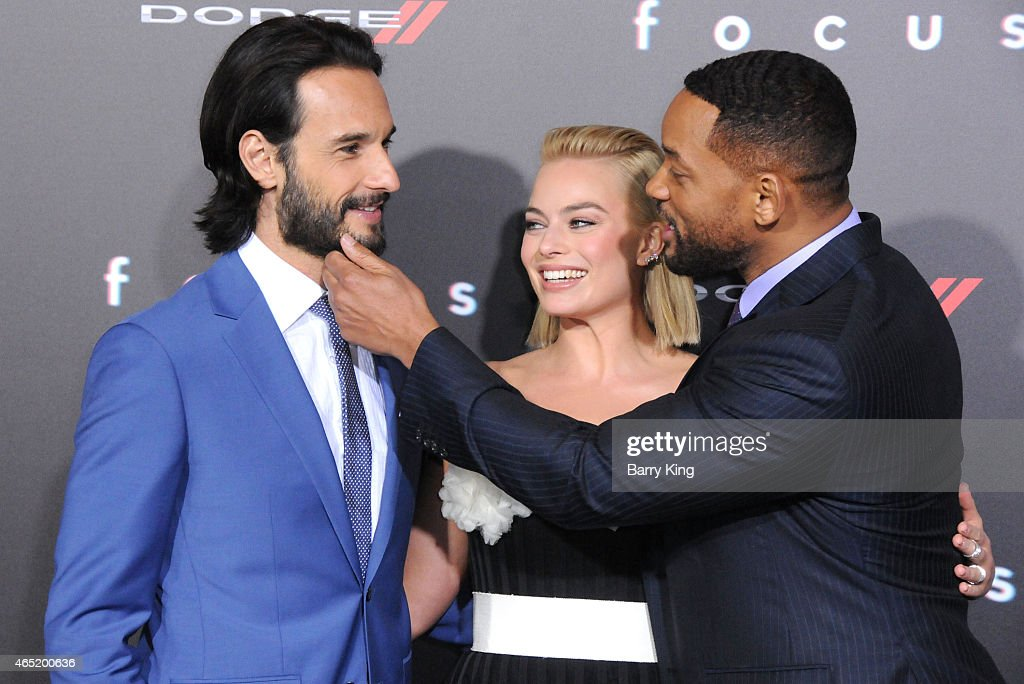 Actor Rodrigo Santoro, actress Margot Robbie and actor Will Smith arrive at the Los Angeles World Premiere Of Warner Bros. Pictures 'Focus' at TCL Chinese Theatre on February 24,2015 in Hollywood, California.