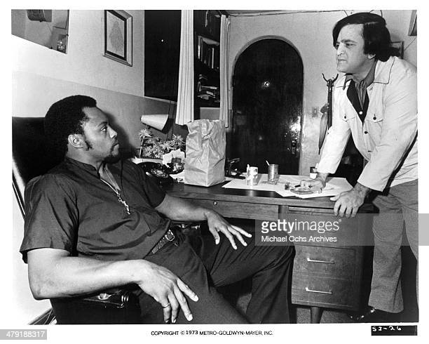 Actor Roger E Mosley and actor Joe Tornatore in a scene from the MGM movie Sweet Jesus Preacherman circa 1973