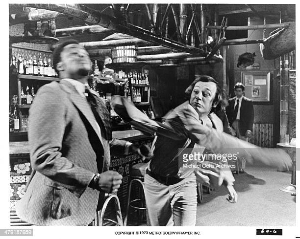 Actor Roger E Mosley is punched in a scene from the MGM movie Sweet Jesus Preacherman circa 1973