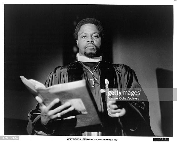 Actor Roger E Mosley stands with bible in a scene from the MGM movie Sweet Jesus Preacherman circa 1973