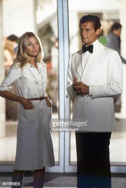 Actor Roger Moore and actress Britt Ekland on the set of 'The Man With The Golden Gun'