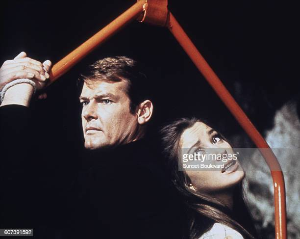"""Actor Roger Moore and actress Jane Seymour on the set of """"Live And Let Die""""."""