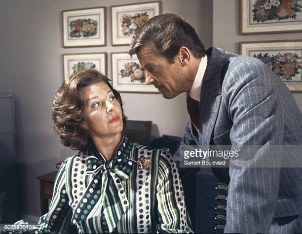 """Actor Roger Moore and actress Lois Maxwell on the set of """"The Spy Who Loved Me""""."""