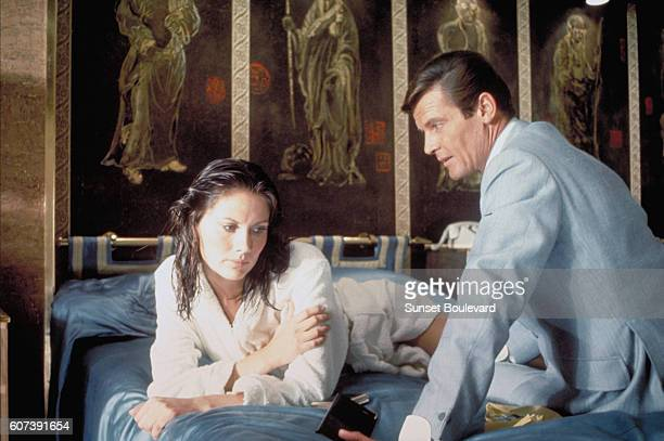 Actor Roger Moore and actress Maud Adams on the set of 'The Man With The Golden Gun'