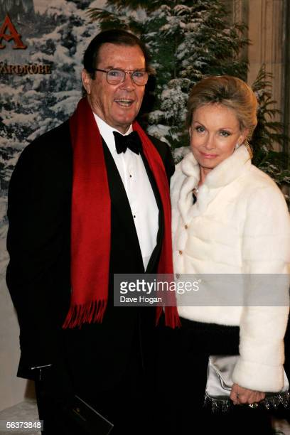 """Actor Roger Moore and his wife Christina """"Kiki"""" Tholstrup arrive at the Royal Film Performance and World Premiere of """"The Chronicles Of Narnia"""" at..."""