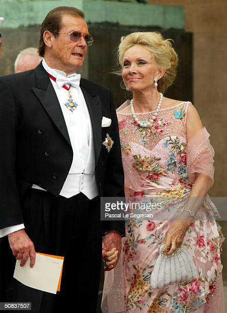 Actor Roger Moore and his wife Christina Tholstrup arrive to attend the wedding between Danish Crown Prince Frederik and Mary Donaldson in Copenhagen...