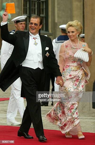 Actor Roger Moore and his wife Christina Tholstrup arrive to the wedding of Danish Crown Prince Frederik and Miss Mary Elizabeth Donaldson in...