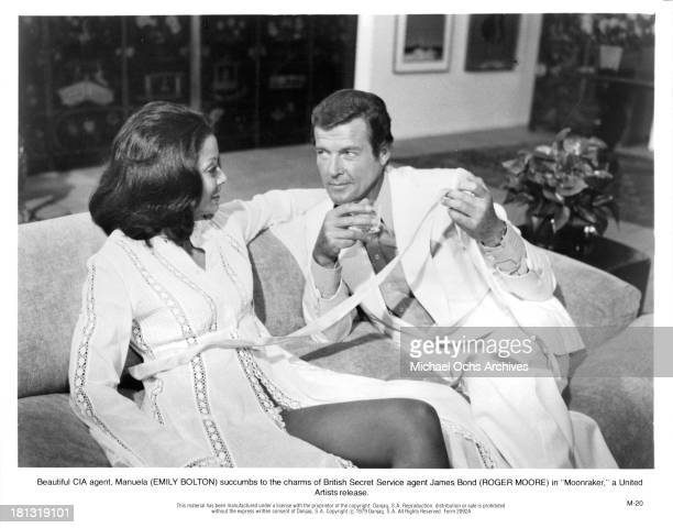Actor Roger Moore as James Bond and actress Emily Bolton as Manuela on set for the United Artist movie ' Moonraker' in 1979
