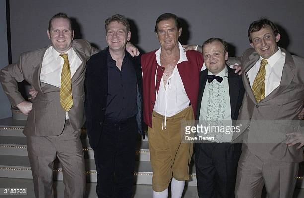 Actor Roger Moore backstage with Kenneth Branagh and the cast on the evening he makes an appearance on the stage as a special guest for 'The Play...