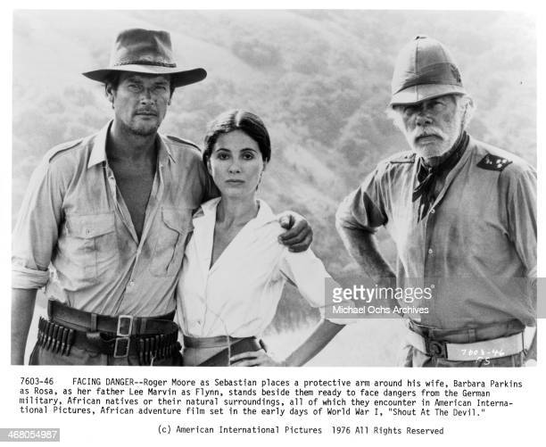 Actor Roger Moore Barbara Parkins and actor Lee Marvin pose on set of the movie Shout at the Devil circa 1976