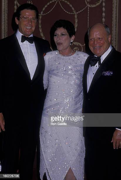 Actor Roger Moore comic Don Rickles and wife Barbara Sklar attend Friar's Club Gala Honoring Barbara Sinatra on May 14 1988 at the Waldorf Hotel in...
