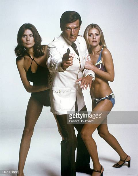 Actor Roger Moore with actresses Maud Adams and Britt Ekland on the set of 'The Man With The Golden Gun'