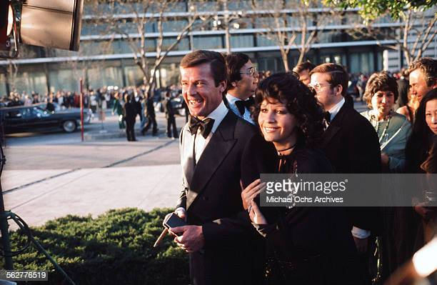 Actor Roger Moore with his wife actress Luisa Mattioli arrives to the 46th Academy Awards at Dorothy Chandler Pavilion in Los AngelesCalifornia