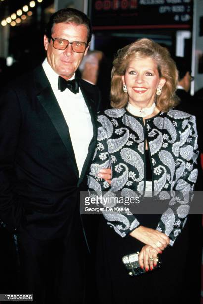 Actor Roger Moore with his wife Luisa Mattioli attend a premiere at the Odeon Cinema in London 1988 circa