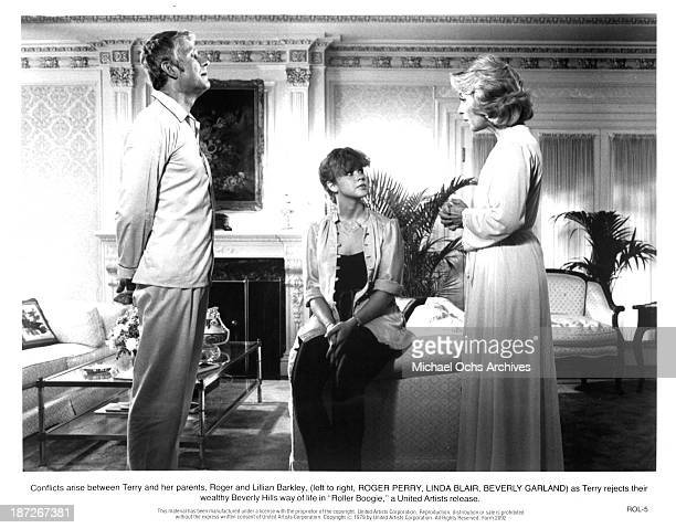 Actor Roger Perry actresses Linda Blair and Beverly Garland on set of the United Artist movie Roller Boogie in 1979
