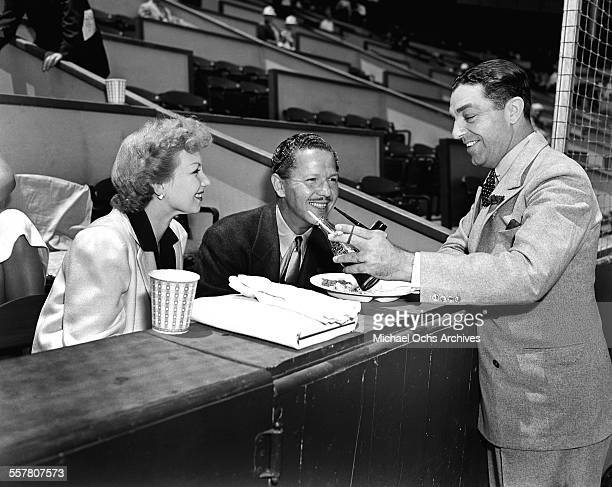 Actor Roger Pryor and his wife actress Ann Sothern attend a tennis match in Los Angeles California