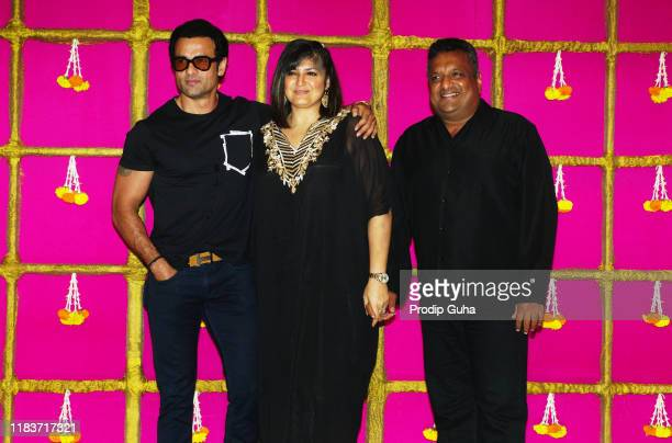 Actor Rohit Roy Producer Sanjay Gupta and his wife Anu Lekhi attend the Diwali Bash hosted by actor and producer Kishan Kumar on October 26 2019 in...