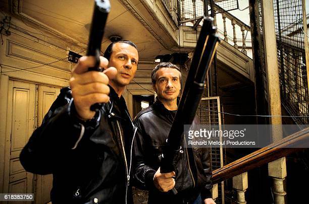 Actor Roland Giraud and Singer Michel Sardou Filming Cross