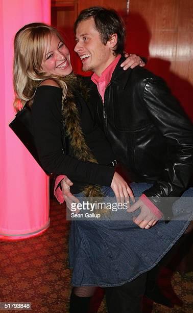 Actor Roman Knizka and girlfriend Stefanie Mensing attend the 'Die Fetten Jahre Sind Vorbei' Premiere at Kino International on November 25 2004 in...